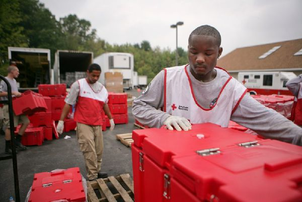 September 4, 2011. Schenectady, New York. Red Cross and AmeriCorps volunteers Mario Jickar and Shannen Collins help load cambros with food provided by a Southern Baptist kitchen in Schenectady, New York. Photo by Talia Frenkel/American Red Cross