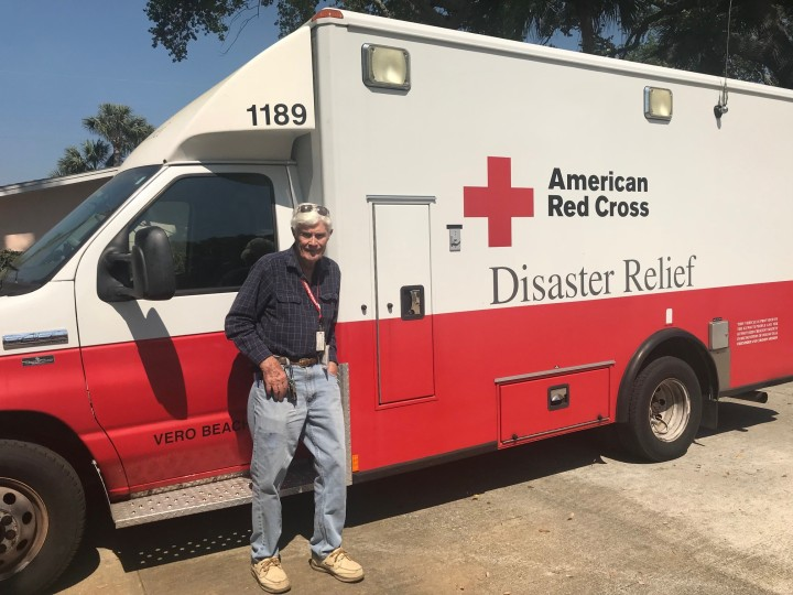 Volunteer Bob Livingston poses by the emergency response vehicle that he drives in Florida's Coast to Heartland Chapter.