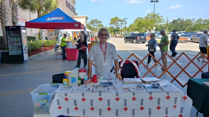 Raybo Frank volunteers at a tabling event distributing information on the Red Cross.